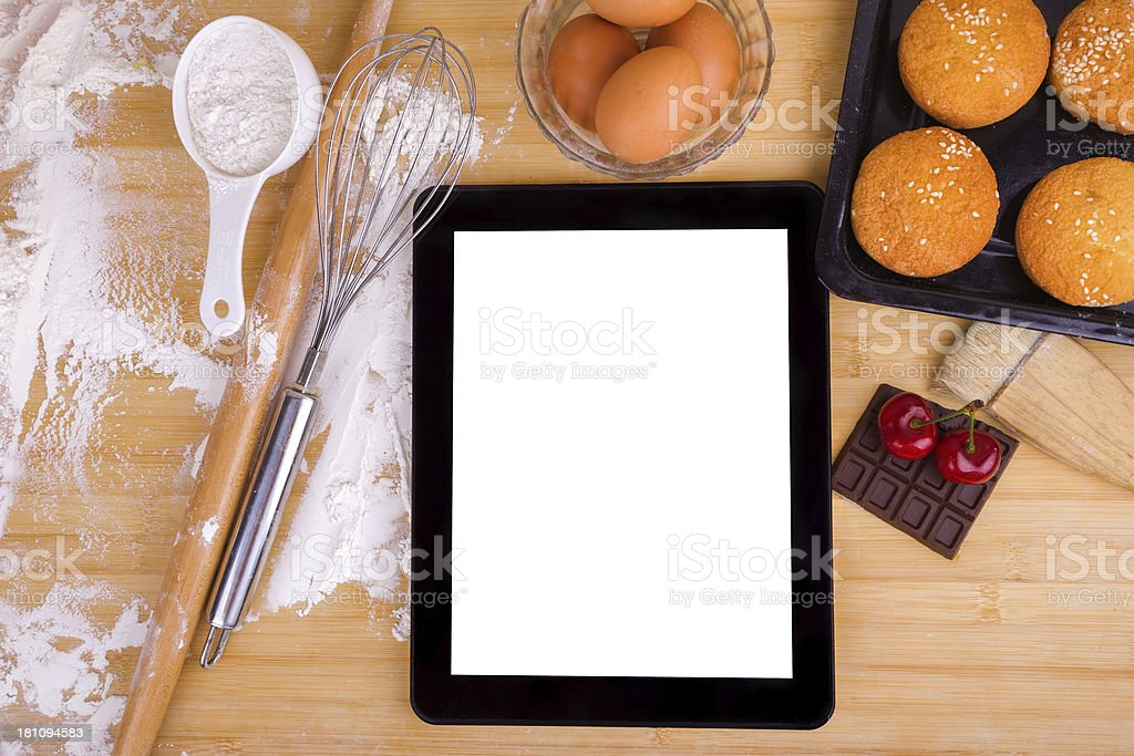 Kitchen utensils and ingredients with digital tablet royalty-free stock photo