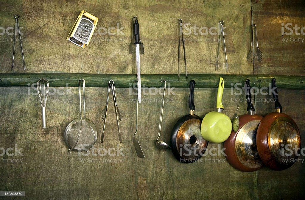 Kitchen utensils hanging royalty-free stock photo