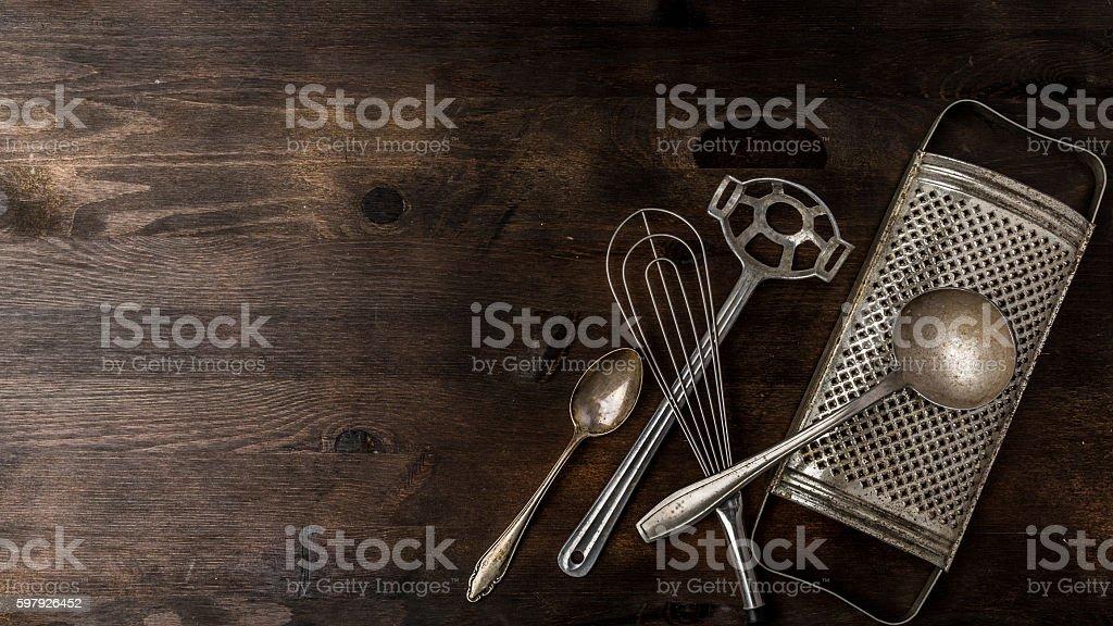 Kitchen utensils on a wooden background stock photo