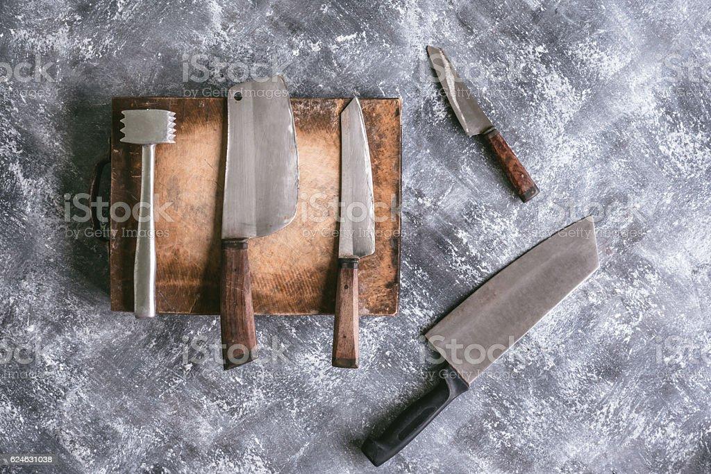 Kitchen utensils on gray grunge background. stock photo
