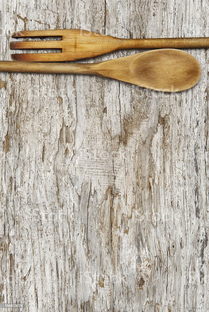 Kitchen utensils on the old wood background royalty-free stock photo