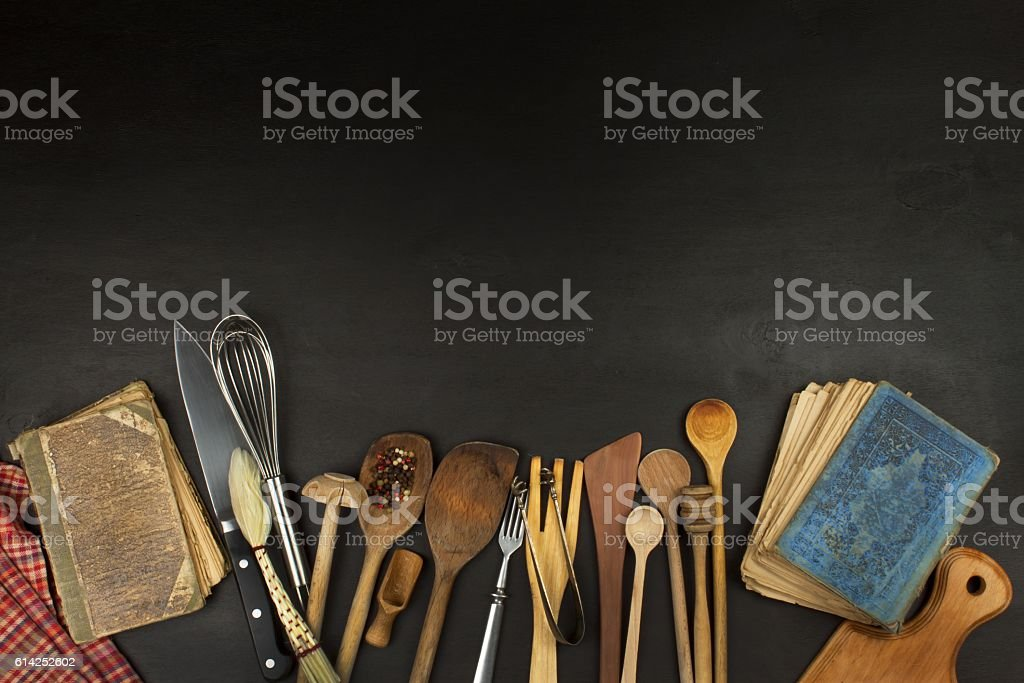 Kitchen utensils on wooden table. Tools cook. Needs to cook. stock photo