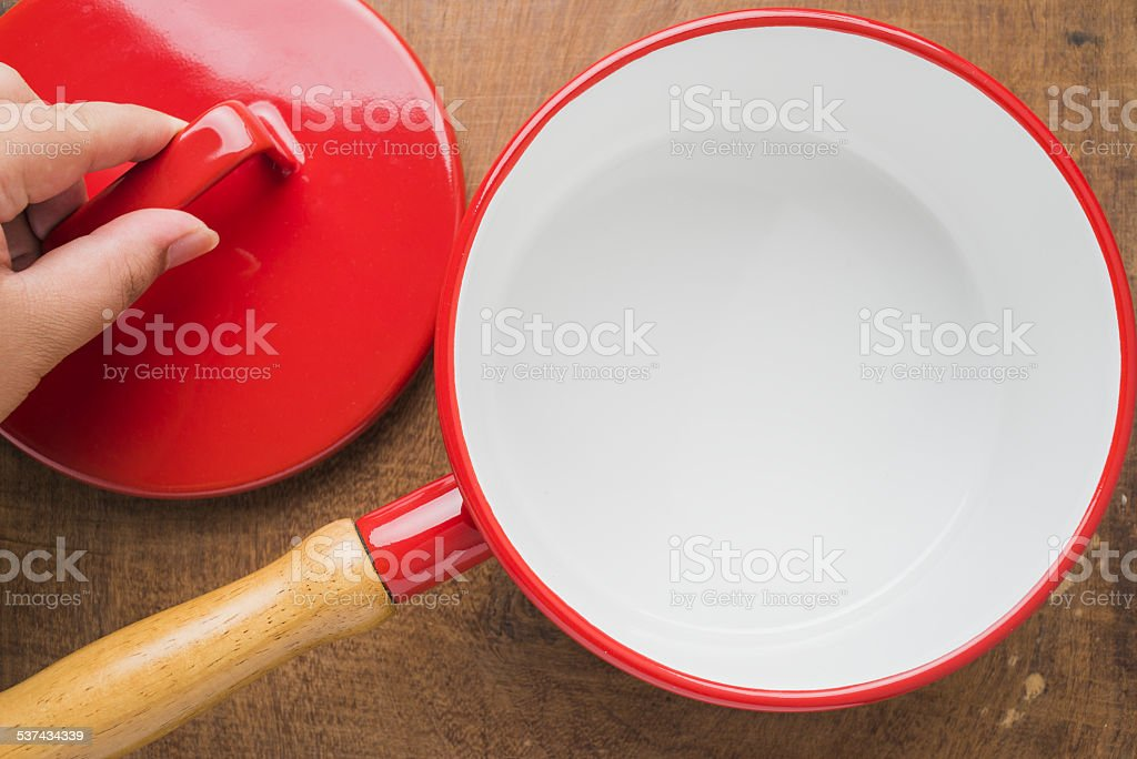 Kitchen utensils red cooking pot stock photo