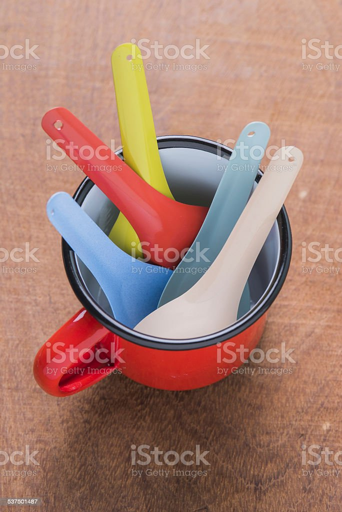 Kitchen utensils red cup stock photo
