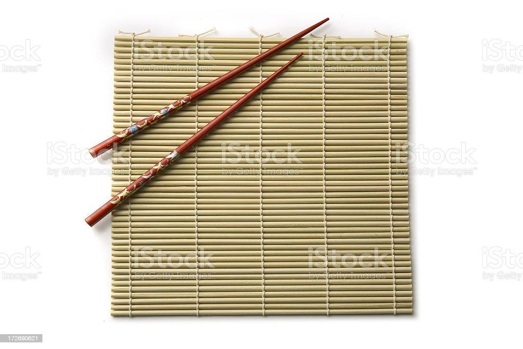 Kitchen Utensils: Sushi Mat and Chopsticks royalty-free stock photo