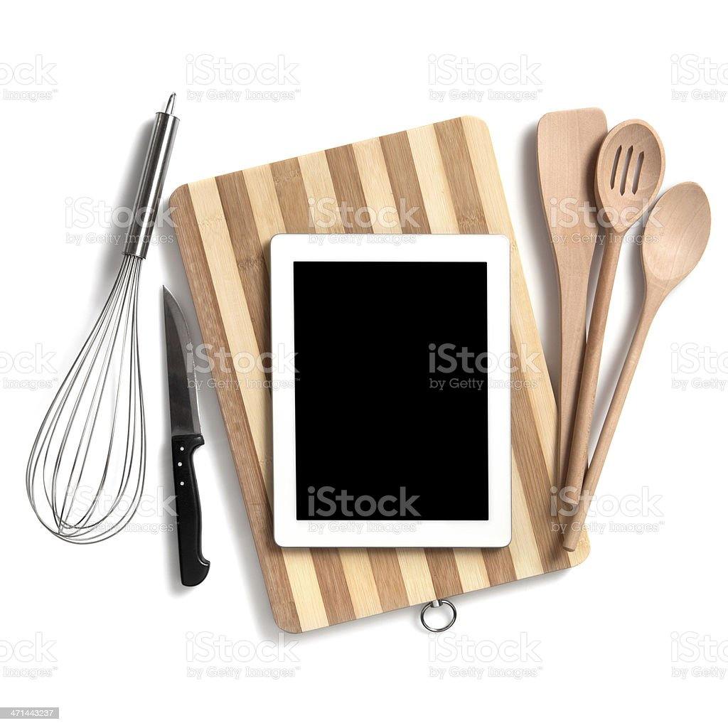 Kitchen utensils with digital tablet stock photo