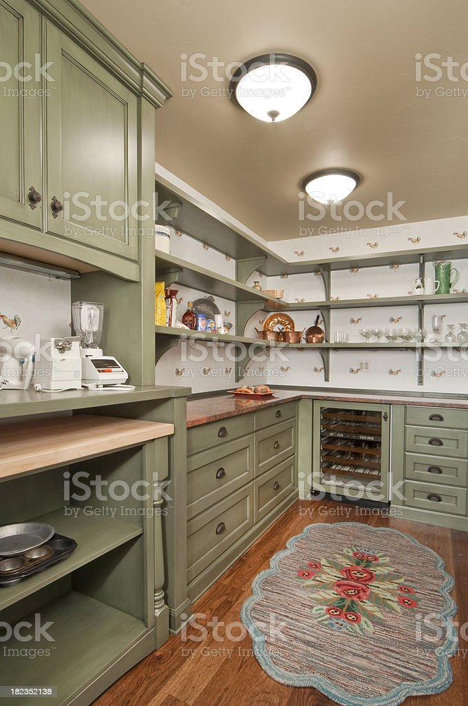 Kitchen with green cabinets royalty-free stock photo
