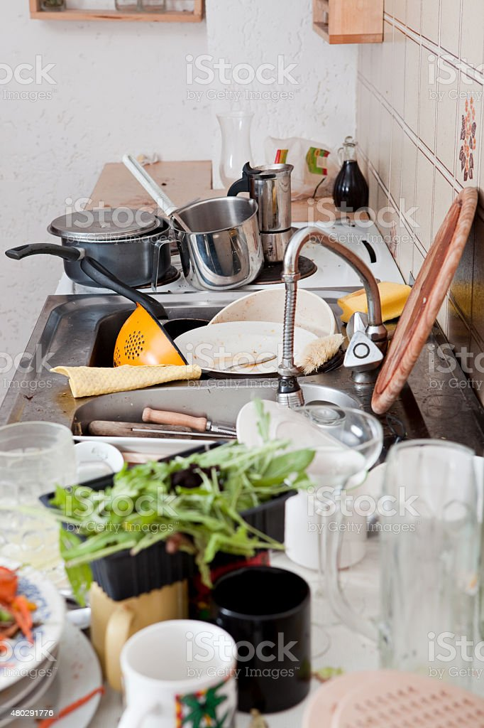 kitchen with messy crockery, leftovers and filthy kitchenware stock photo