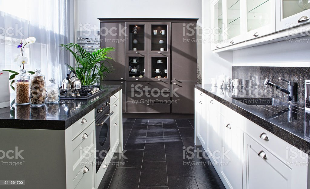 kitchen with stainless steel appliances stock photo