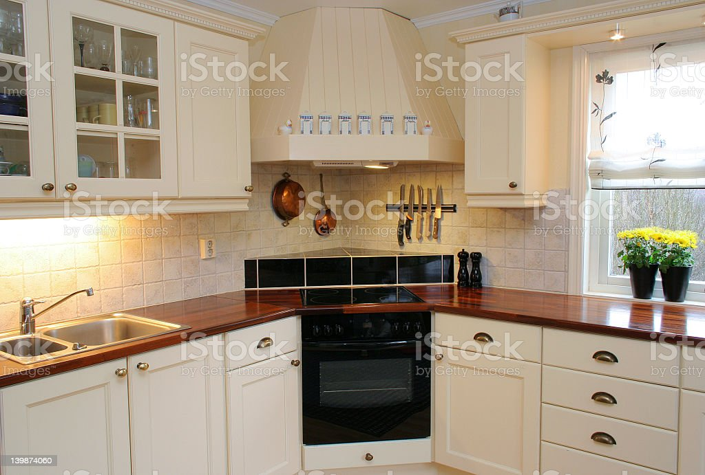 Kitchen with white 90s style cabinets stock photo