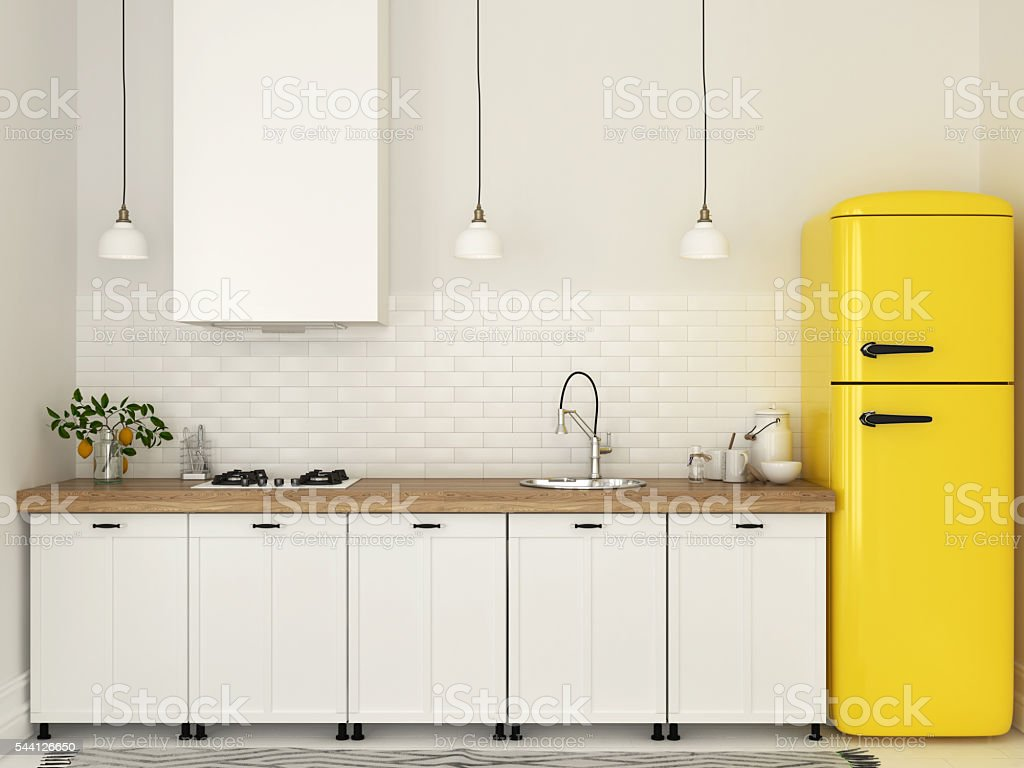 Kitchen with white furniture and a yellow fridge stock photo