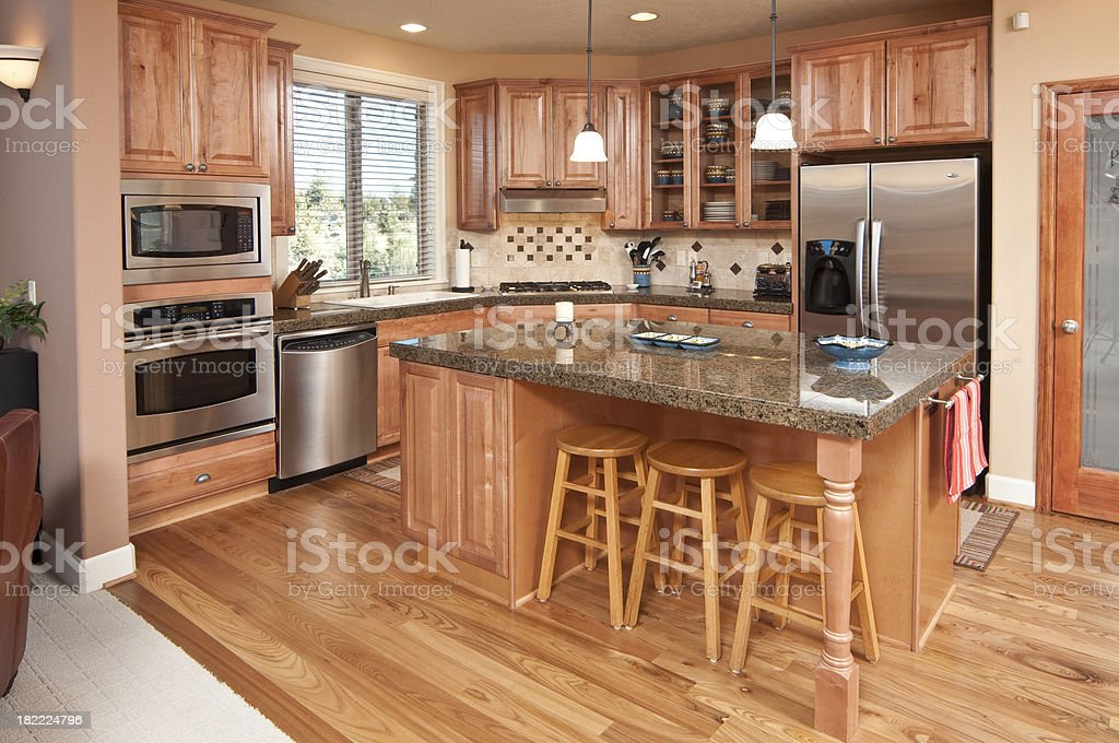Kitchen with wood cabinets and floors stock photo