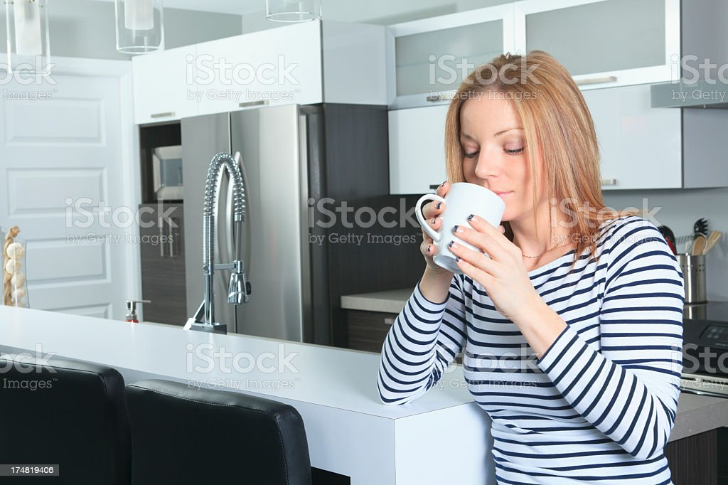 Kitchen - Young Woman Smell Tea royalty-free stock photo