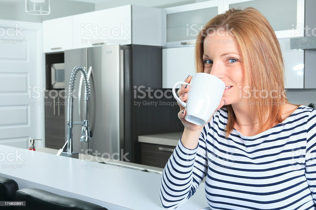 Kitchen - Young Woman Smile Tea royalty-free stock photo