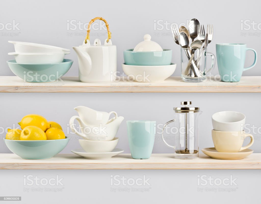 Kitchenware on wooden shelves stock photo