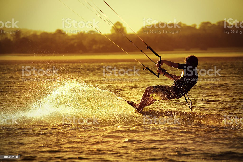 Kite boarder in yellow morning light stock photo