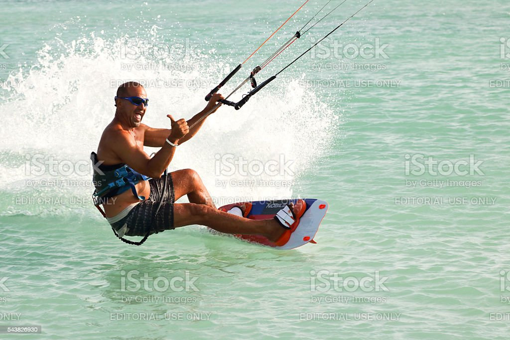 Kite Boarder thumbs up as he executes an extreme maneuver stock photo