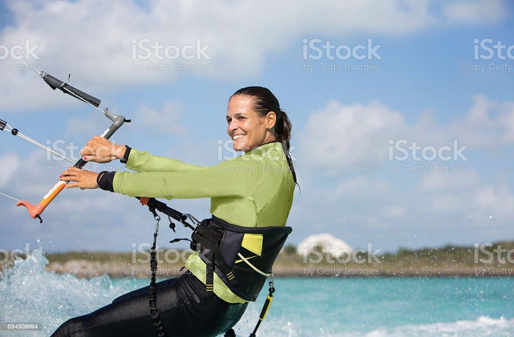 Kite Boarding Woman in the Caribbean. stock photo