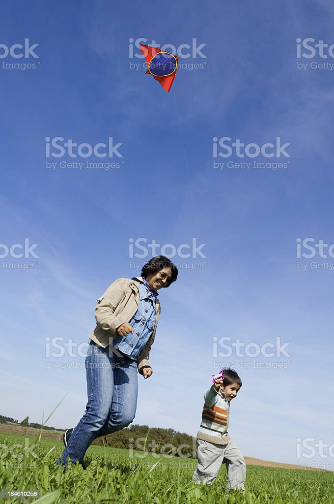 kite flying boy and woman stock photo