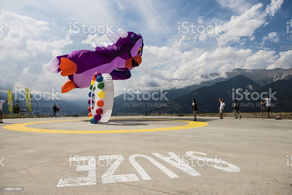 Kite Flying in a Cloudy Sky stock photo