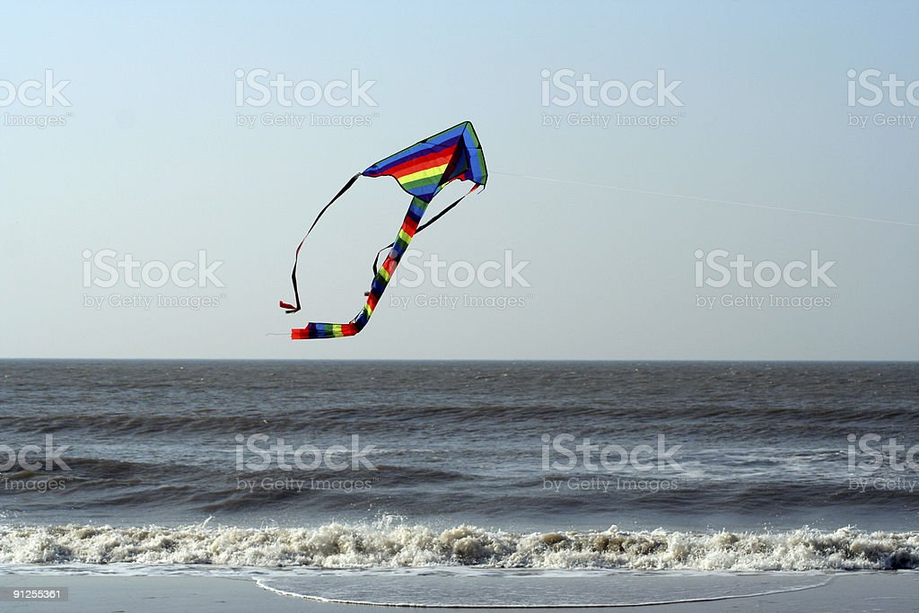 Kite Flying Over The Ocean royalty-free stock photo