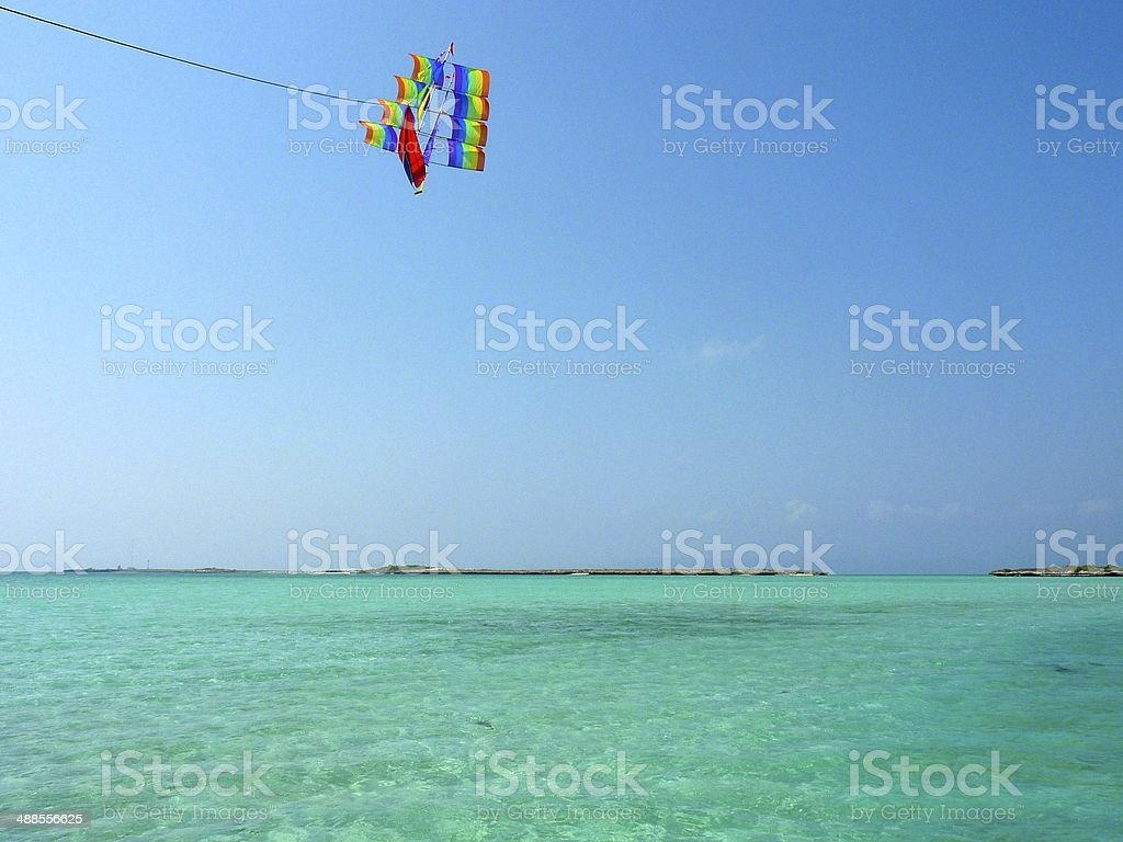 Kite flying over the turquoise sea royalty-free stock photo