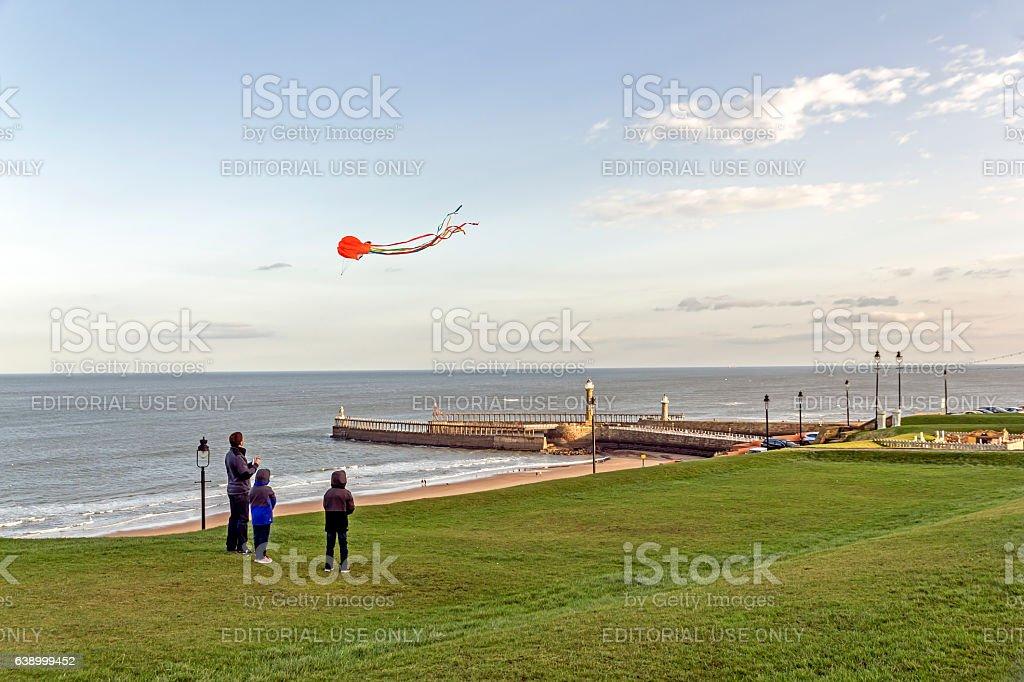 Kite Flying Whitby, North Yorkshire. stock photo