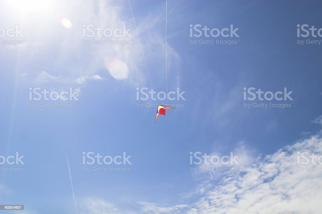 Kite in front of cloud royalty-free stock photo