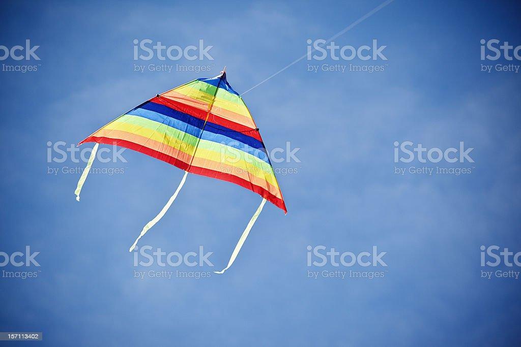 Kite in the blue sky stock photo