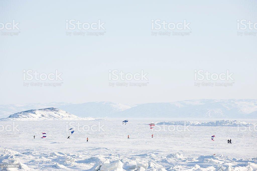 Kite Skiing on Frobisher Bay, Baffin Island. stock photo