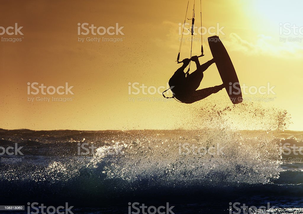 Kite surfer in action stock photo