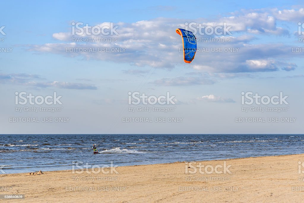 Kite surfer making tricks near Baltic sea coastline stock photo