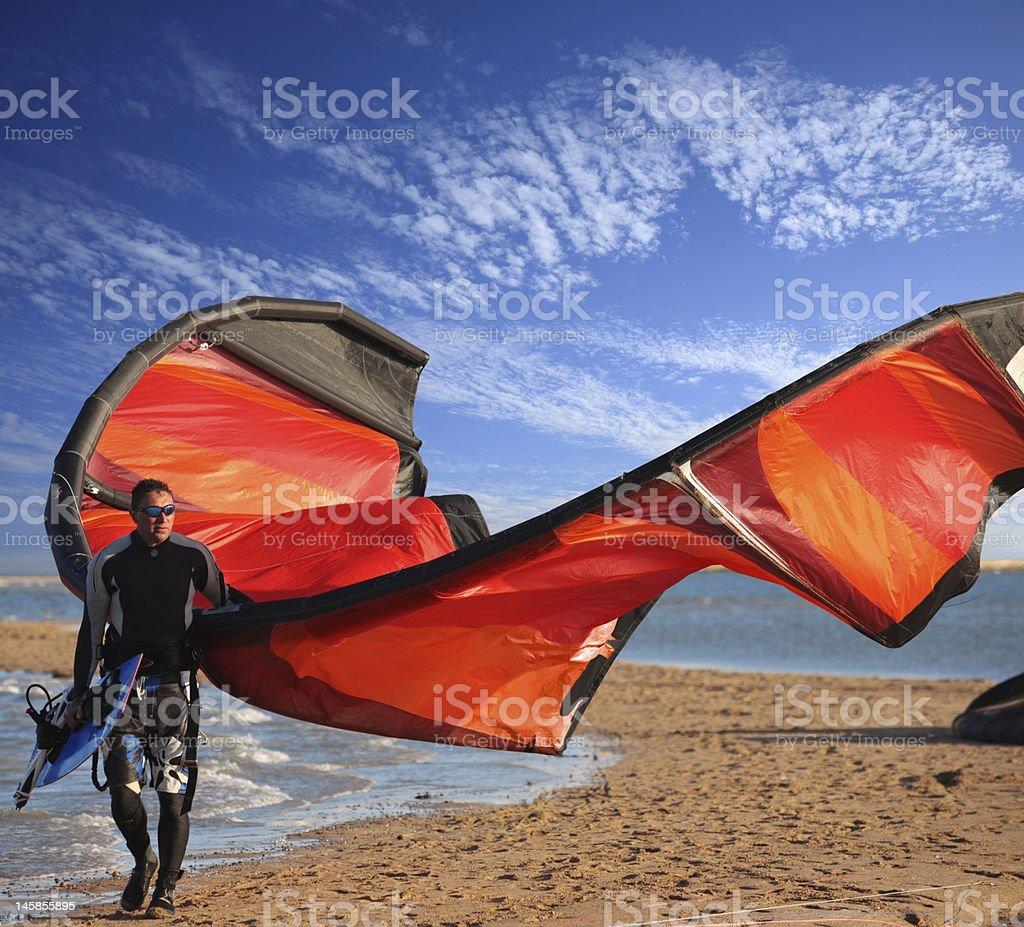 kite surfer on the beach stock photo