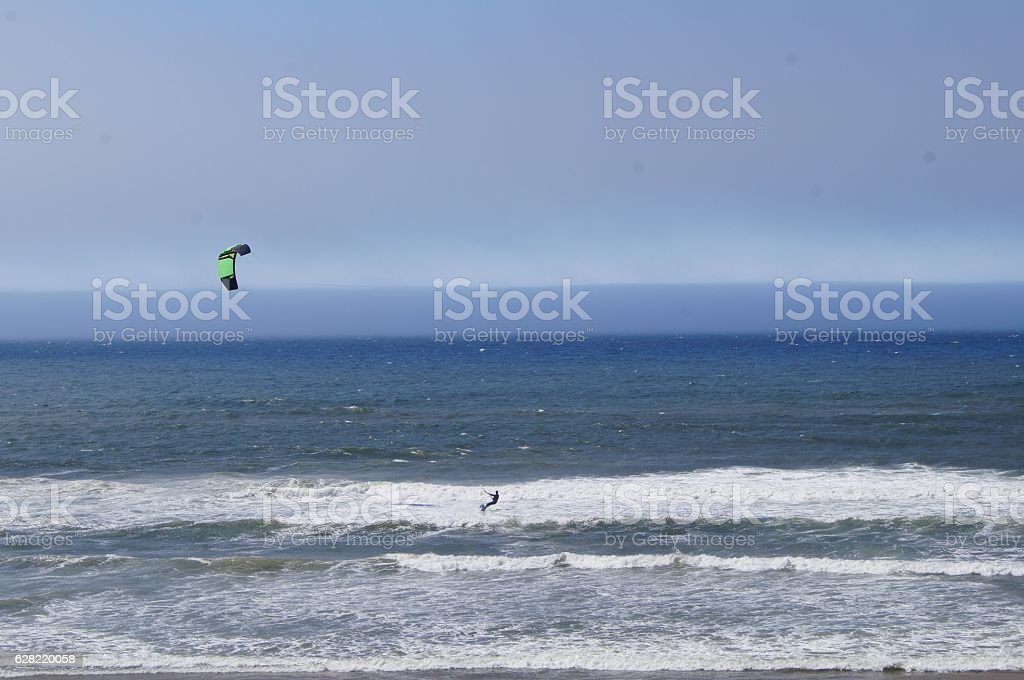 Kite Surfer Riding a Wave into the Pacific Ocean stock photo