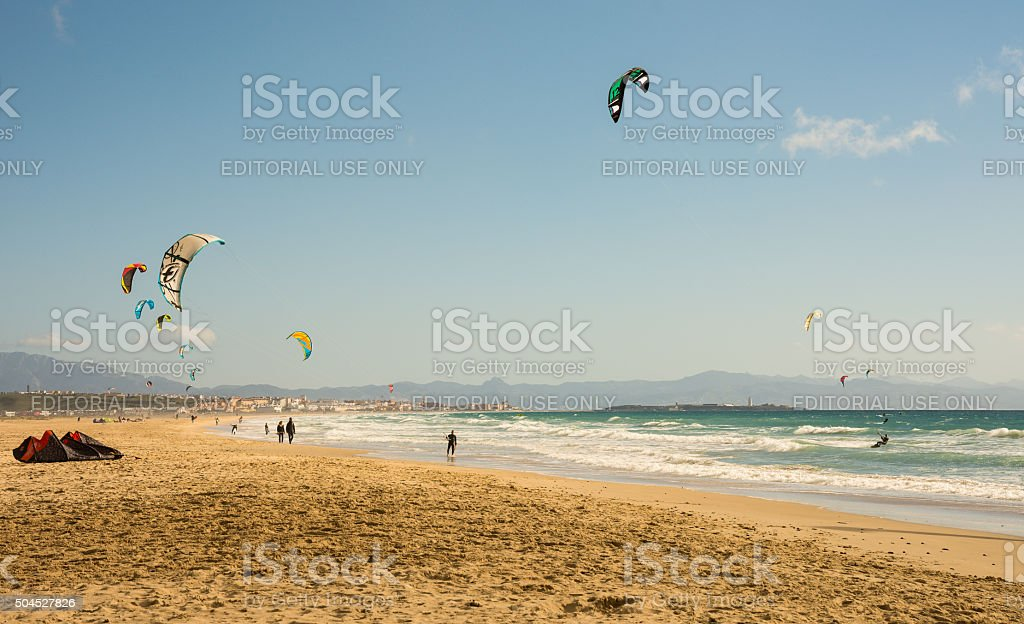 Kite surfers on a sunny winter day in Tarifa area stock photo