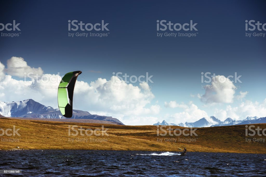 Kite surfing at mountain lake stock photo
