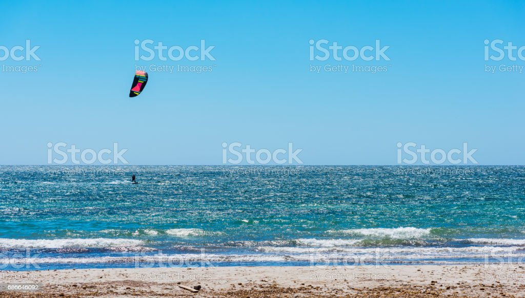 Kite surfing on a clear day stock photo