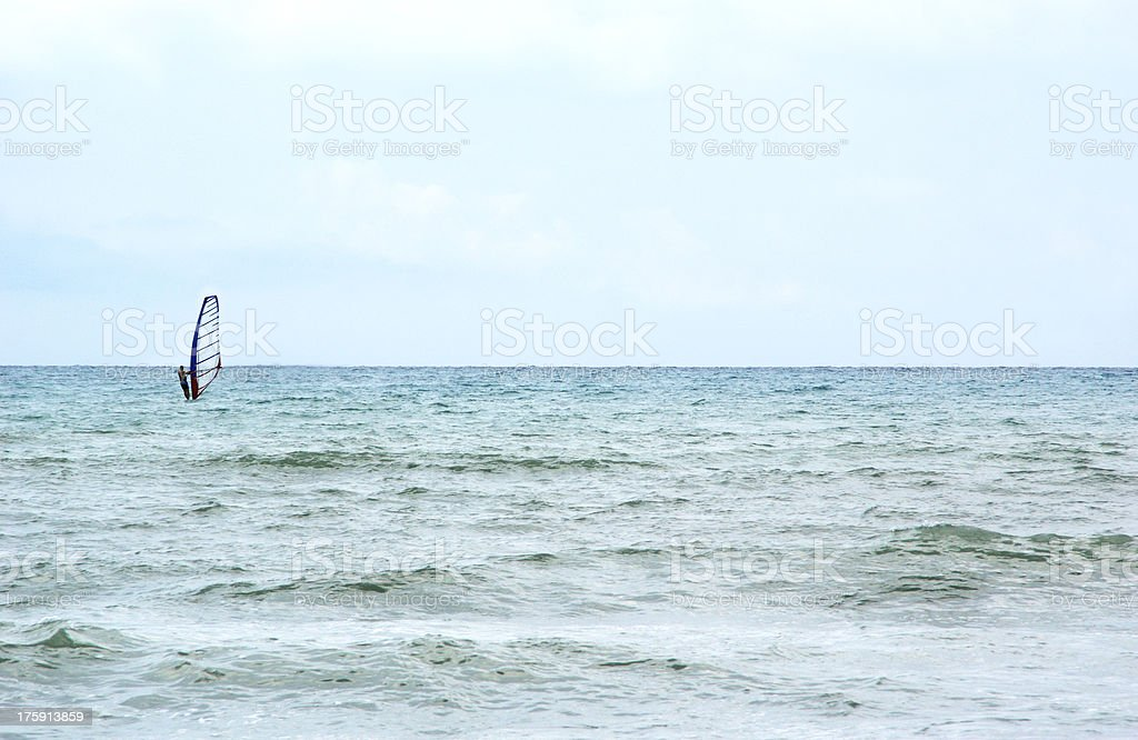 Kiteboarder enjoy surfing in the sea royalty-free stock photo