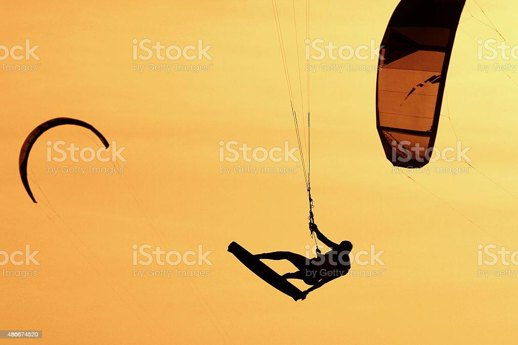 Kiteboarder silhouette stock photo