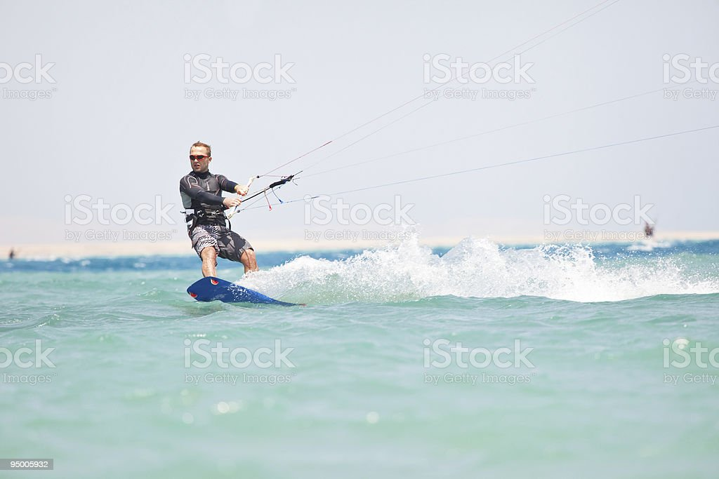 Kiteboarder surfing royalty-free stock photo