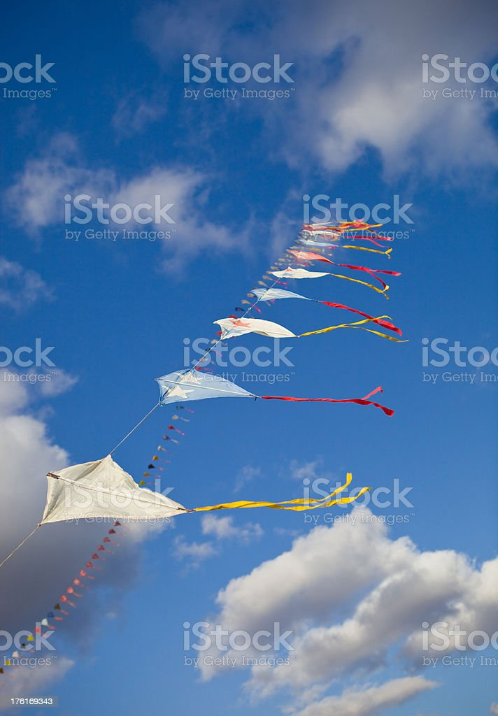 Kites Flying on String in Blue Sky and Clouds stock photo