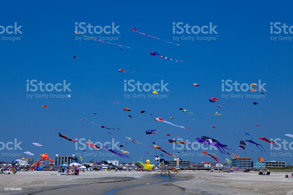 Kites in a clear blue sky stock photo