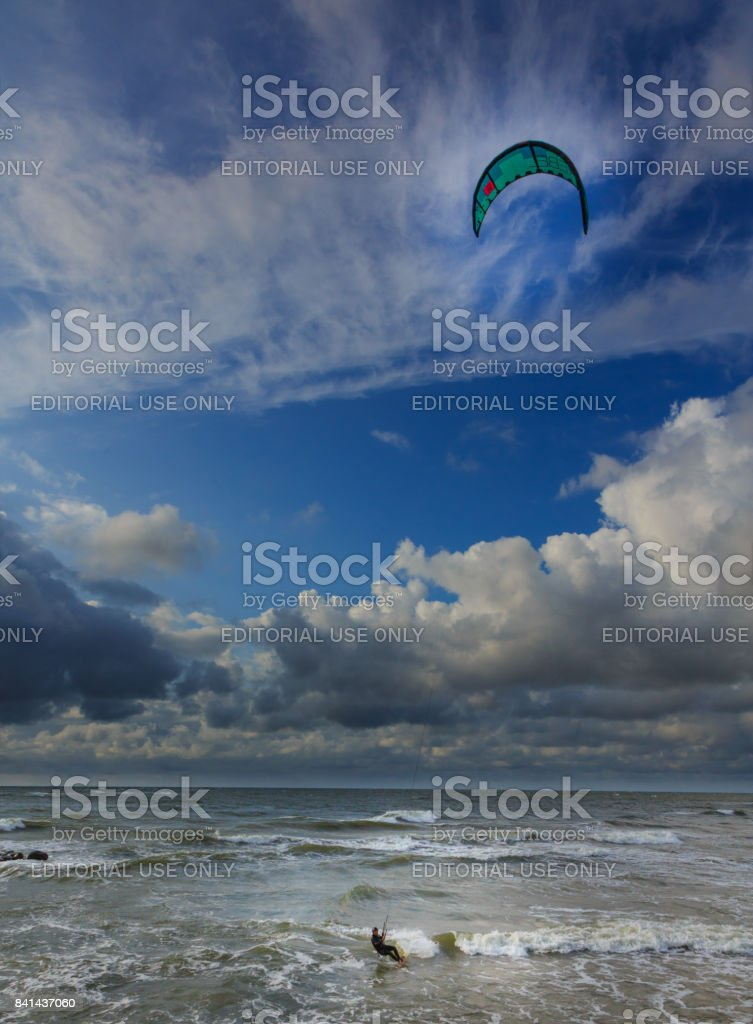 Kitesurfer against blue cloudy sky stock photo