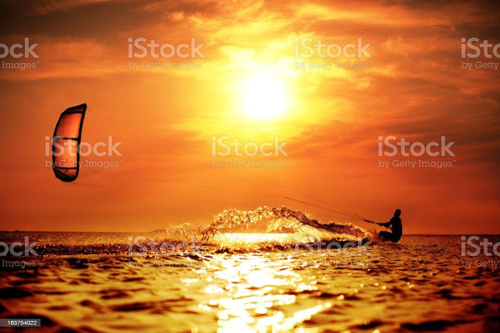 Kitesurfer at Sunset stock photo