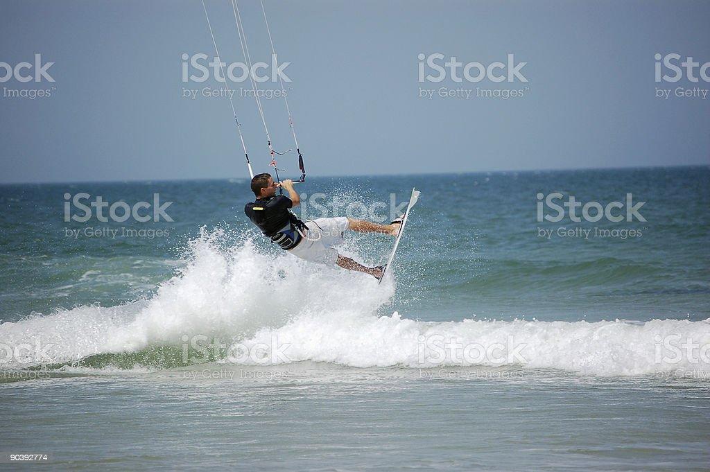 Kitesurfer launching off a breaker royalty-free stock photo