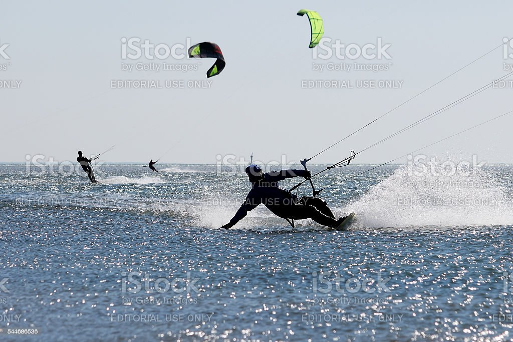 Kitesurfers in action - waves with sprinkle water stock photo