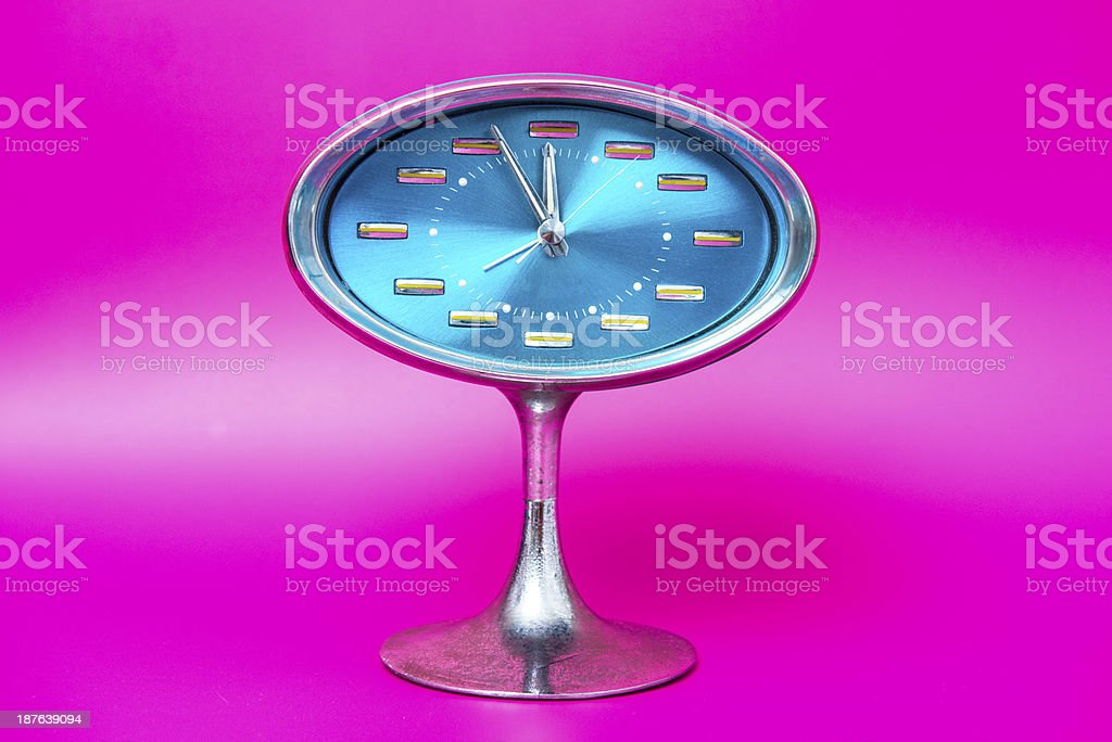 Kitsch alarm clock on pink royalty-free stock photo
