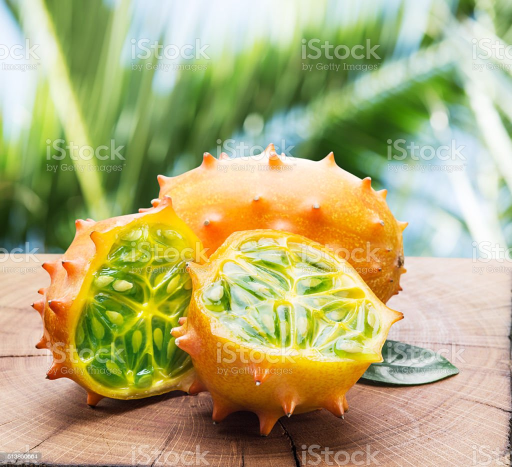 Kiwano fruits on the wooden table. stock photo