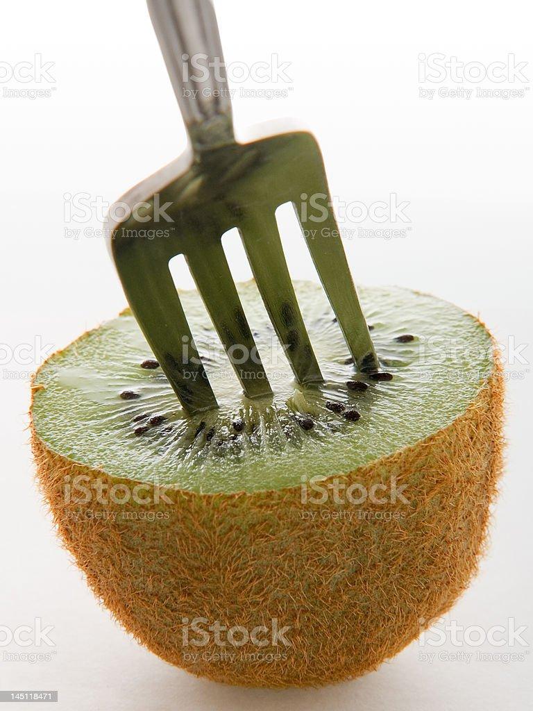 Kiwi and fork stock photo