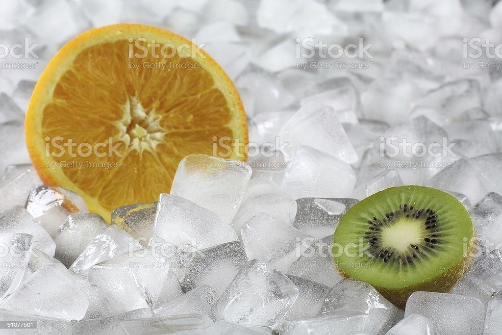 Kiwi and Oranges on Ice royalty-free stock photo